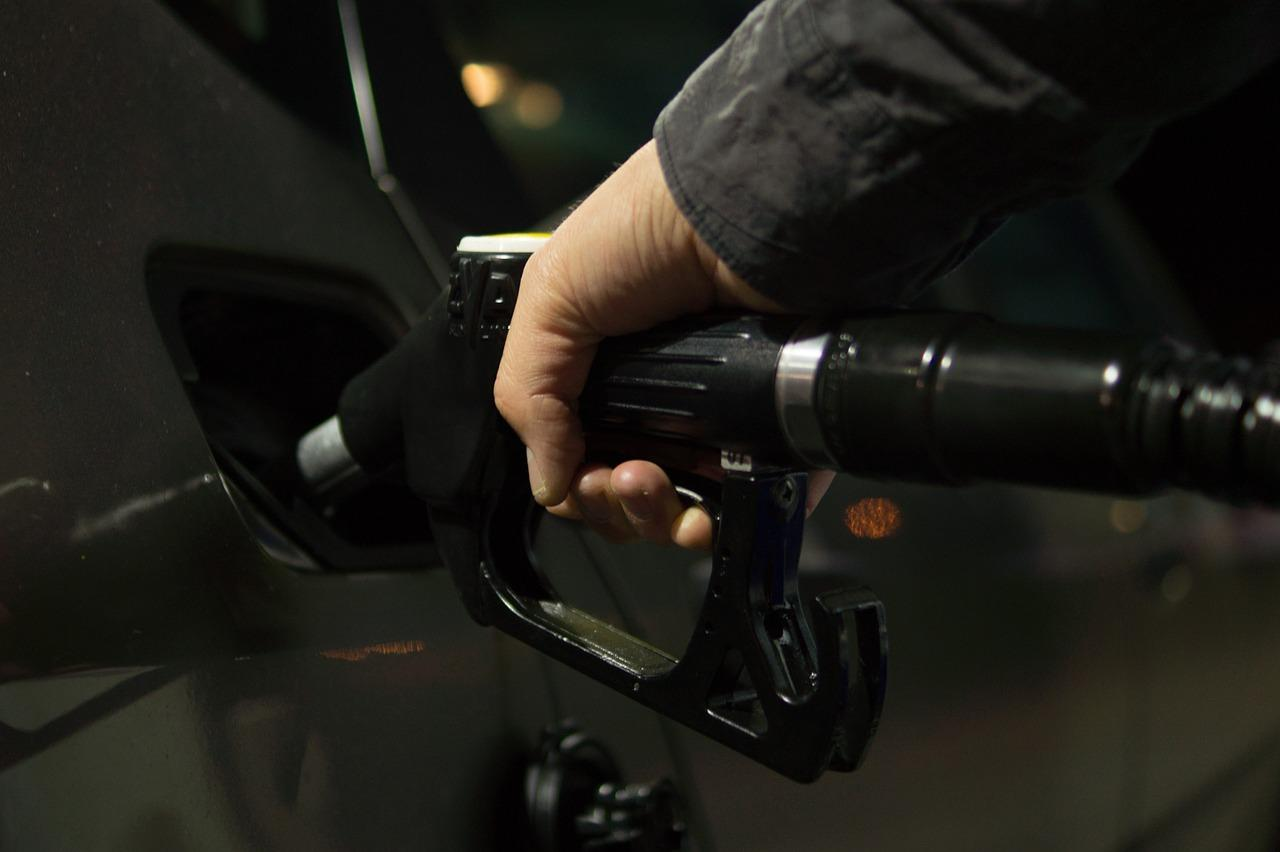 Person filling a car's gas tank